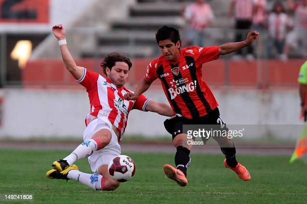 Oscar Zea of Nexaca and Jorge Zarate of Jaguares fight for the ball during a match between Jaguares v Necaxa as part of the Copa MX 2012 at Victor...
