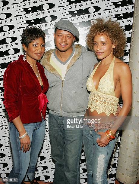 Oscarnominated actor Terrence Howard poses with Uptown Magazine associate publisher Jocelyn Taylor and television personality Stacie J at a 310...
