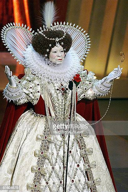 Oscar's Host Whoopi Goldberg dressed as Queen Elizabeth I of England opens the 71st Academy Awards 21 March 1999 at the Dorothy Chandler Pavilion in...