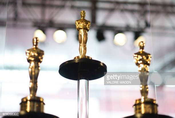 Oscars statuettes stand on display during a preview for the Governors Ball during the 90th annual Academy Awards week in Hollywood California March...