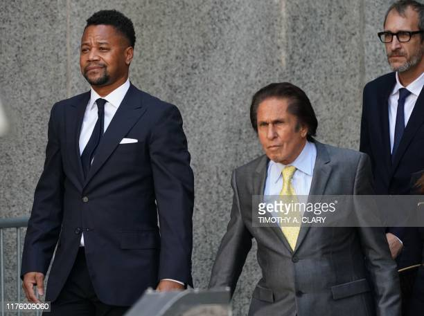 Oscarwinning actor Cuba Gooding Jr departs his court arraignment with his lawyer Mark Hellerin New York October 15 in New York on October 15 2019...