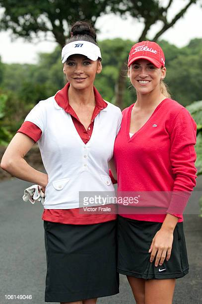 Oscarwinning actress Catherine ZetaJones and Belen Mozo of Spain pose ahead of the inaugural Mission Hills Star Trophy on October 27 2010 in Haikou...