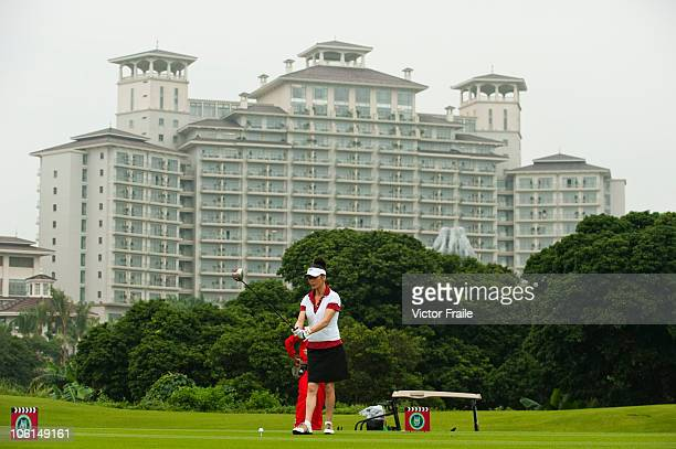 Oscarwinning actress Catherine ZetaJones plays a practice shot ahead of the inaugural Mission Hills Star Trophy on October 27 2010 in Haikou China...