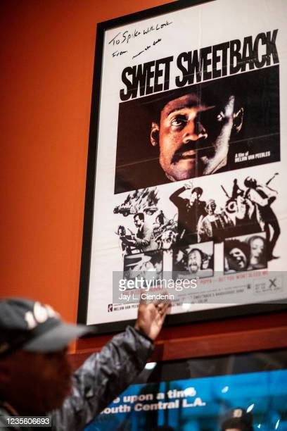 Oscar-winning director Spike Lee points out an autographed poster from director Melvin Van Peebles, who recently died, from his private collection...
