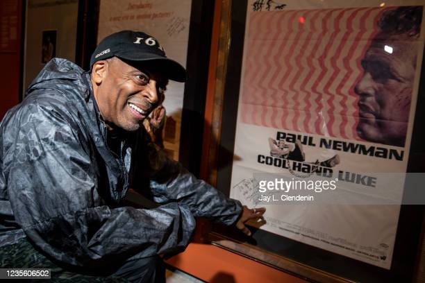 Oscar-winning director Spike Lee points out Paul Newmans autograph, To Spike who is Luke incarnate, on an original poster of Cool Hand Luke, while...