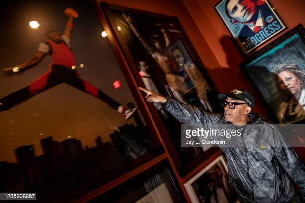 Oscar-winning director Spike Lee points out some favorite photos, autographed by many of the subjects in the pictures, like this 1985 Nike Jumpman...