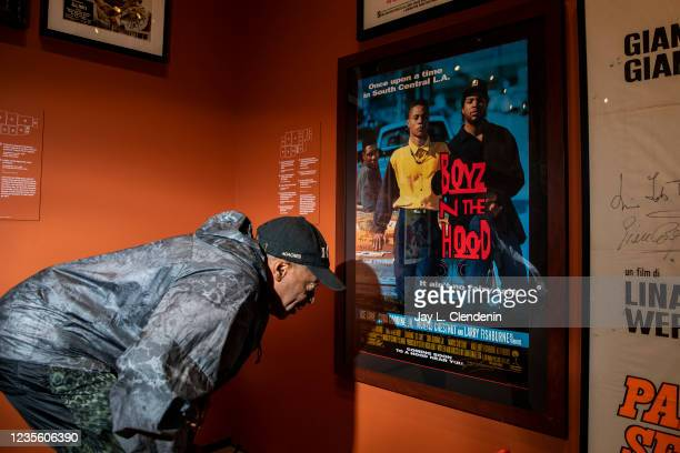 Oscar-winning director Spike Lee reads a message from director John Singleton on an original poster for Singletons Boyz N The Hood, from his private...