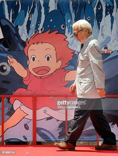 Oscarwinning Japanese animator and film director Hayao Miyazaki walks past a advertising board for a photo session following the release of his new...