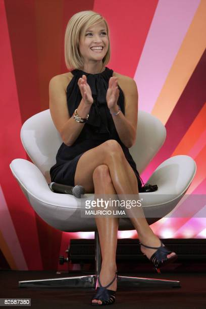 Oscarwinning star of 'Walk the Line' and 'Legally Blonde' US actress Reese Witherspoon applauds during an event to spread a message of female...