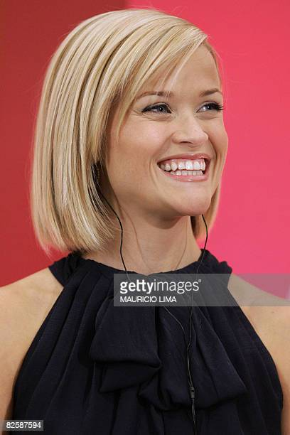 Oscarwinning star of 'Walk the Line' and 'Legally Blonde' US actress Reese Witherspoon smiles during an event to spread a message of female...