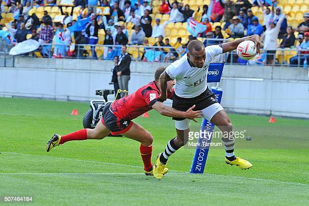 Osea Kolinisau of Fiji crosses the try line during the 2016 Wellington Sevens match between Fuji and Wales at Westpac Stadium on January 30, 2016 in...