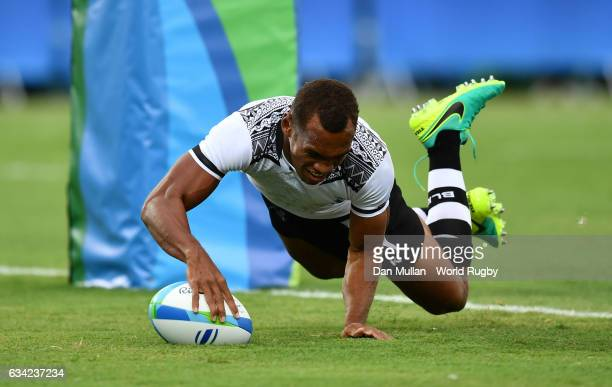 Osea Kolinisau of Fiji dives over for a try during the Men's Rugby Sevens Pool A match between Fiji and the United States on Day five of the Rio 2016...