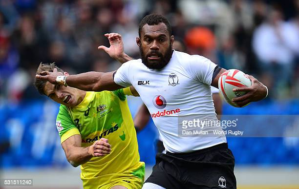 Osea Kolinisau of Fiji hands off Edward Jenkins of Australia during the Cup Quarter Final match between Fiji and Australia on day three of the HSBC...