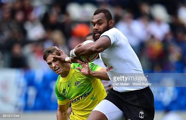 Osea Kolinisau of Fiji hands off Edward Jenkins of Australia during the Cup Quarter Final match between Fiji and Australia on day three of the HSBC...