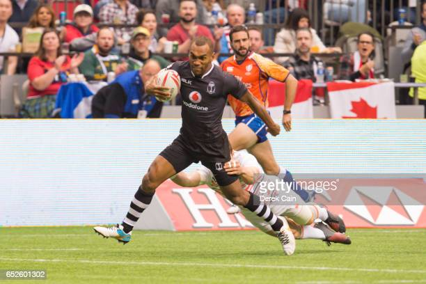 Osea Kolinisau of Fiji is pulled down against England during day 2 of the 2017 Canada Sevens Rugby Tournament on March 12, 2017 in Vancouver, British...
