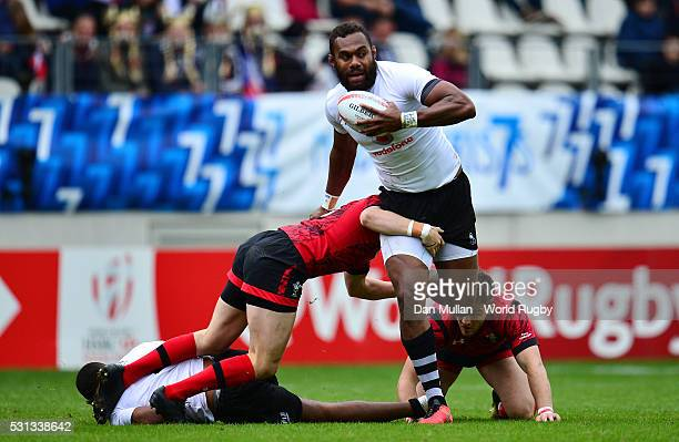 Osea Kolinisau of Fiji is tackled by Angus O'Brien of Wales during the pool match between Fiji and Wales on day two of the HSBC Paris Sevens at the...