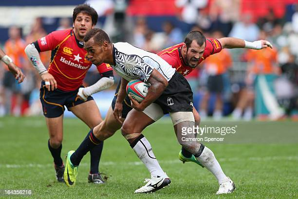 Osea Kolinisau of Fiji is tackled during the match between Fiji and Spain during day two of the 2013 Hong Kong Sevens at Hong Kong Stadium on March...