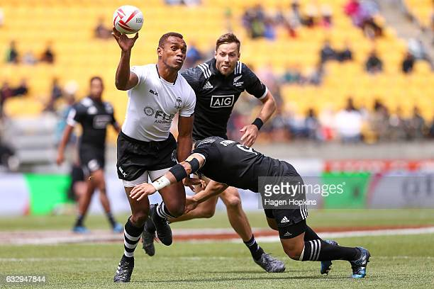 Osea Kolinisau of Fiji looks to pass in the Cup Quarter Final match between New Zealand and Fiji during the 2017 Wellington Sevens at Westpac Stadium...