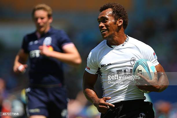 Osea Kolinisau of Fiji makes a break to score a try during the 2014 Gold Coast Sevens Pool C match between Fiji and Scotland at Cbus Super Stadium on...