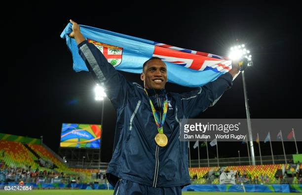 Osea Kolinisau of Fiji poses with the Fiji flag following victory during the Men's Rugby Sevens Gold Medal match between Fiji and Great Britain on...