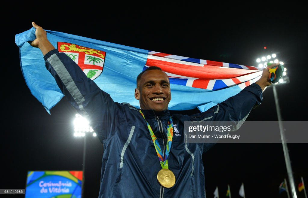 Osea Kolinisau of Fiji poses with the Fiji flag following victory during the Men's Rugby Sevens Gold Medal match between Fiji and Great Britain on day six of the Rio 2016 Olympic Games at Deodoro Stadium on August 11, 2016 in Rio de Janeiro, Brazil.