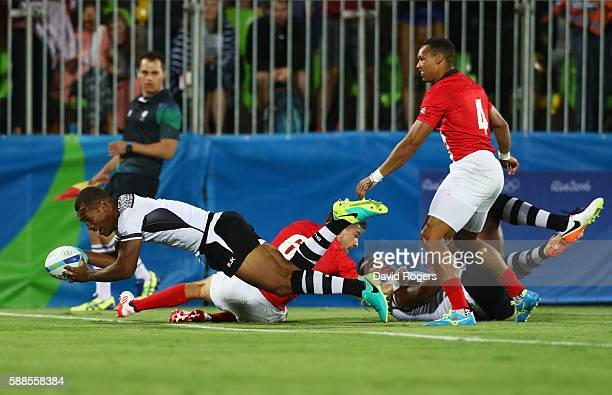 Osea Kolinisau of Fiji scores a try during the Men's Rugby Sevens Gold medal final match between Fiji and Great Britain on Day 6 of the Rio 2016...