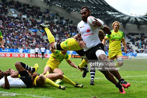 Osea Kolinisau of Fiji scores a try past Patrick McCutcheon of Australia during the Cup Quarter Final match between Fiji and Australia on day three...