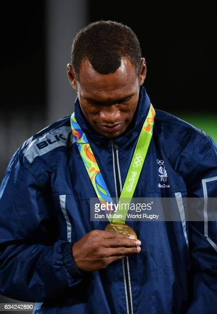 Osea Kolinisau of Fiji stands on the podium with his gold medal following the Men's Rugby Sevens Gold Medal match between Fiji and Great Britain on...