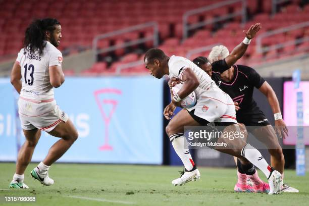 Osea Kolinisau of Old Glory DC handles the ball defended by Ryan James of the LA Giltinis at Los Angeles Coliseum on May 01, 2021 in Los Angeles,...