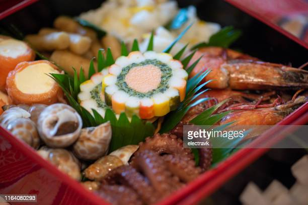 osechi ryori on new year's day in japan - osechi ryori stock pictures, royalty-free photos & images