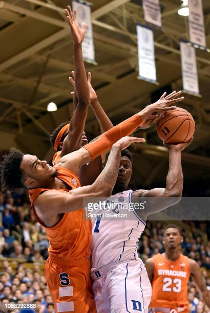 Oshae Brissett ad Paschal Chukwu of the Syracuse Orange defend Zion Williamson of the Duke Blue Devilsduring their game at Cameron Indoor Stadium on...