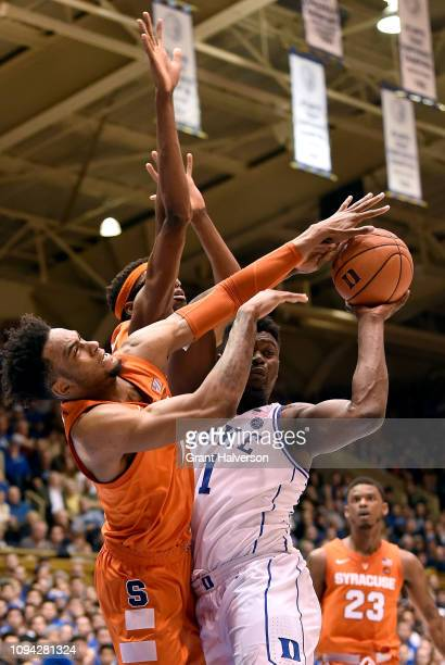 Oshae Brissett ad Paschal Chukwu of the Syracuse Orange defend Zion Williamson of the Duke Blue Devils during a game at Cameron Indoor Stadium on...