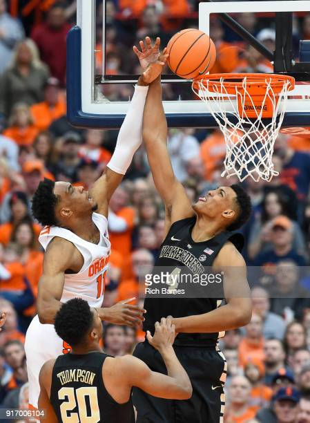 Oshae Brissett of the Syracuse Orange attempts to dunk the ball against the defense of Doral Moore of the Wake Forest Demon Deacons during the first...
