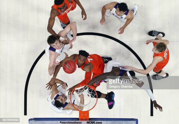 Oshae Brissett of the Syracuse Orange battles for a rebound with JD Miller of the TCU Horned Frogs in the first round of the 2018 NCAA Men's...