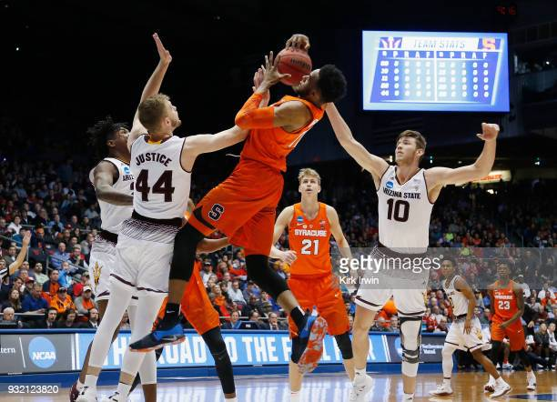 Oshae Brissett of the Syracuse Orange battles for the ball against Kodi Justice and Vitaliy Shibel of the Arizona State Sun Devils in the first half...