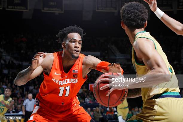 Oshae Brissett of the Syracuse Orange defends against Prentiss Hubb of the Notre Dame Fighting Irish in the second half of the game at Purcell...