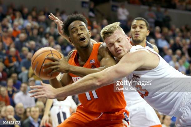 Oshae Brissett of the Syracuse Orange draws a foul from Jack Salt of the Virginia Cavaliers in the first half during a game at John Paul Jones Arena...