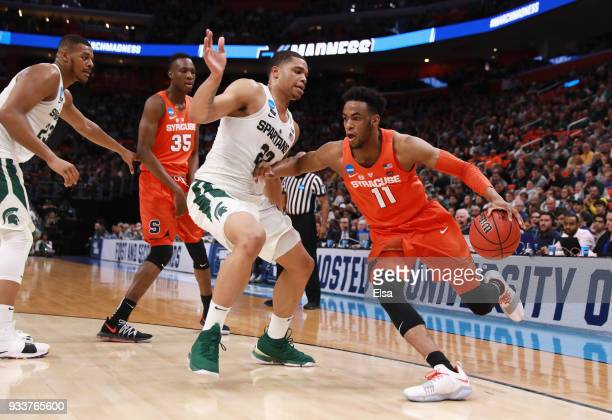 Oshae Brissett of the Syracuse Orange dribbles during the first half against the Michigan State Spartans in the second round of the 2018 NCAA Men's...