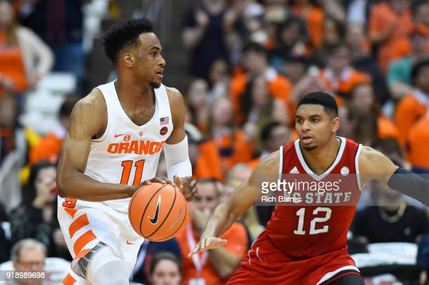 Oshae Brissett of the Syracuse Orange drives to the basket against the defense of Allerik Freeman of the North Carolina State Wolfpack during the...