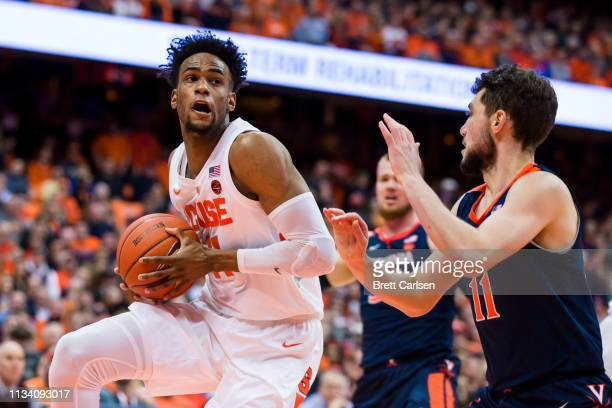 Oshae Brissett of the Syracuse Orange drives to the basket against Ty Jerome of the Virginia Cavaliers during the second half at the Carrier Dome on...