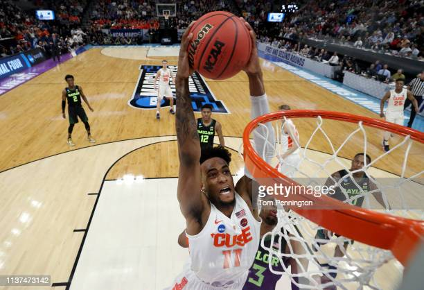 Oshae Brissett of the Syracuse Orange dunks the ball against Freddie Gillespie of the Baylor Bears during the first half in the first round of the...