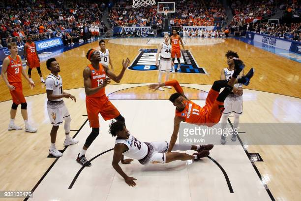 Oshae Brissett of the Syracuse Orange falls after driving to the basket in the first half against the Arizona State Sun Devils during the First Four...