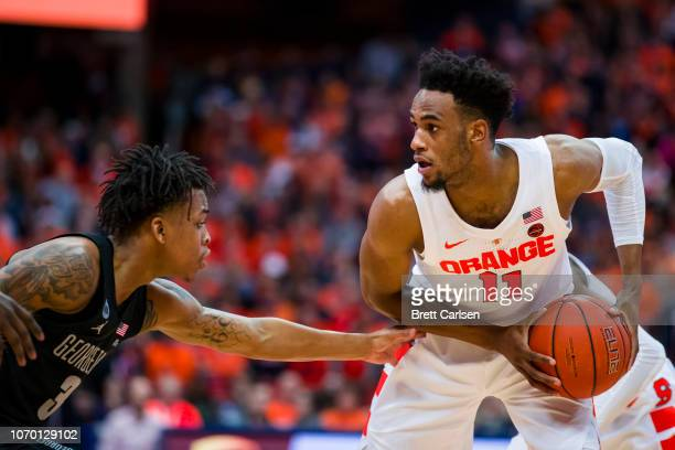 Oshae Brissett of the Syracuse Orange handles the ball against James Akinjo of the Georgetown Hoyas during the second half at the Carrier Dome on...