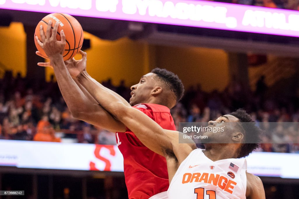 Oshae Brissett #11 of the Syracuse Orange knocks the ball out of bounds while trying to rebound against Matt Morgan #10 of the Cornell Big Red at the Carrier Dome on November 10, 2017 in Syracuse, New York. Syracuse defeats Cornell 77-45.