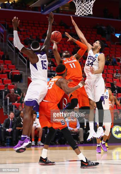 Oshae Brissett of the Syracuse Orange shoots the ball against Kenrich Williams and JD Miller of the TCU Horned Frogs during the second half in the...