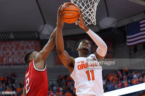 Oshae Brissett of the Syracuse Orange shoots the ball as Torin Dorn of the North Carolina State Wolfpack defends during the first half at the Carrier...