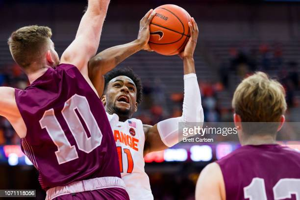 Oshae Brissett of the Syracuse Orange shoots the ball as Will Rayman of the Colgate Raiders defends during the second half at the Carrier Dome on...