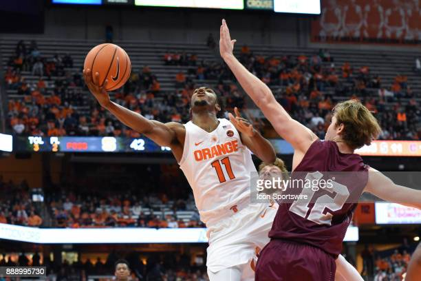 Oshae Brissett of the Syracuse Orange shoots the ball defended by Dana Batt of the Colgate Raiders during the second half of play between the...