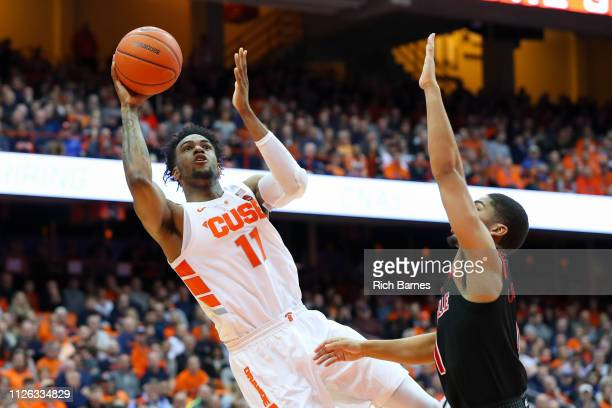 Oshae Brissett of the Syracuse Orange shoots the ball past Christen Cunningham of the Louisville Cardinals during the second half at the Carrier Dome...