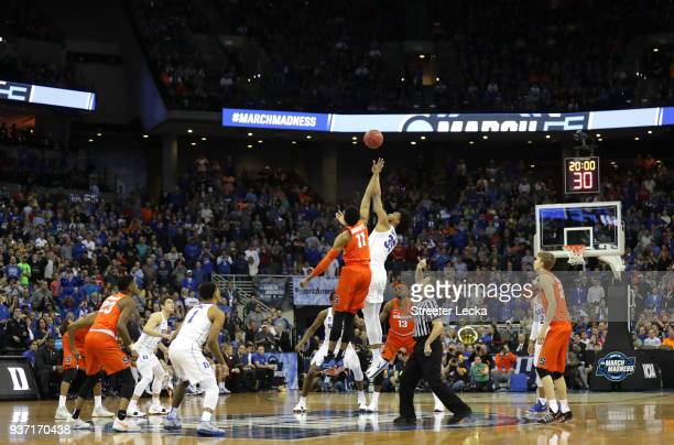 Oshae Brissett of the Syracuse Orange tips off against Marvin Bagley III of the Duke Blue Devils to start the first half in the 2018 NCAA Men's...